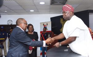 Lagos State Governor, Mr. Akinwunmi Ambode (right), congratulating the Chairman, Board of Neighbourhood Safety Corp Agency, DIG Israel Ajao (rtd.) during the inauguration of the Board at the Conference Room, Lagos House, Ikeja, on Wednesday, November 23, 2016. With them is Director, Legislative Drafting, Ministry of Justice, Mrs. Yejide Kolawole.